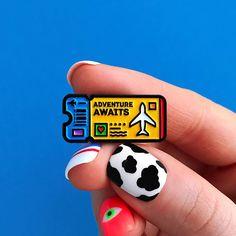 Yellow ticket enamel pin