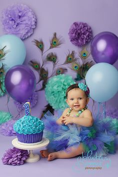Purple and Teal peacock birthday cake smash 1st Birthday Photos, Baby Girl Birthday, Birthday Parties, Birthday Ideas, Peacock Birthday Party, Girls First Birthday Cake, One Year Birthday, Birthday Decorations, Giant Cupcake Cakes