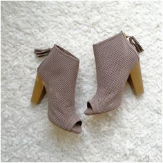 """LISTING! NIB Taupe Cut-Out Ankle Booties NIB Taupe Cut-Out Ankle Booties. These versatile booties feature a perforated vegan suede with side cut-outs, peep toe, and a chunky stacked heel. Tassel pull on a gold back-zip closure at the heel. Lightly padded insole, approx 4"""" heel. FITS TRUE TO SIZE. Available in 5.5, 6, 6.5, 7, 7.5, 8, 8.5, 9, 10. No Trades and No PaypalPrice is firm unless bundled, also available in black, see my closet for black listing. Shoes Ankle Boots & Booties"""