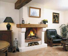 cheminée ouverte design habillage déco mur idée fauteuil noir cuir tableau mur