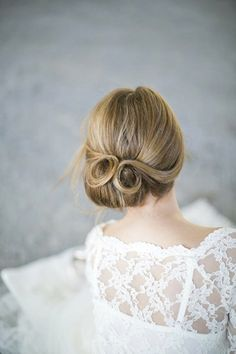 wedding hair.......Retro-Glam If you're inspired by vintage wedding details, borrow your hairstyle from a different decade, too, with curls and twists that would make any pin-up starlet jealous. Side-parted hair in the front, curls in the back.....