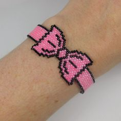 Hot Pink and Black Bead Woven Graphic Bow Bracelet