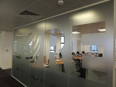 Glass office room divider Glass Office Partitions, Glass Partition, Corporate Interiors, Office Interiors, Frosted Glass Sticker, Office Room Dividers, Glass Room Divider, Cool Office Space, Interior Windows