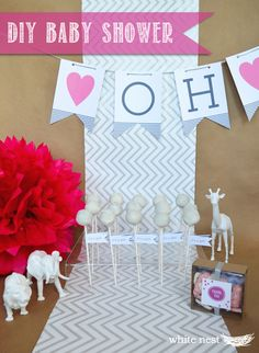 White Nest | DIY Baby Shower Ideas | Girl Baby Shower | Baby Banner | Cake Pops | Pom poms | Animal Centerpieces | Animal Cookie Favors #baby #party #DIY