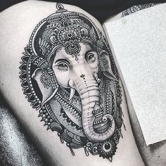 9. Alluring animal icon on the thighThis black thigh ink shows a majestic elephant, adorned with a traditional Indian decoration. If you see this tattoo – be sure that the owner is balanced and wise.