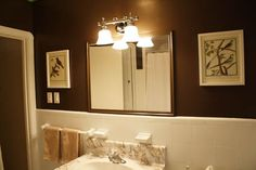 Modern Bathroom With Beautiful Light Fixtures Design Ideas Bathroom Interior With Brown Wall Paint Colors And Lighting Fixtures Over Mirror Bathroom Light Fixtures, Brown Bathroom, Brown Bathroom Decor, Wall Paint Colors, Bathroom Interior, Brown Walls, Beadboard Bathroom, Bathroom Design, Master Bedroom Bathroom