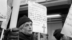 Daniel Berrigan marching with about 40 others outside of the Riverside Research Center in New York (09 April 1982)