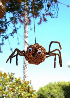Something for the kids. Simple pine cone spiders to hang around the yard. #Halloween #Crafts