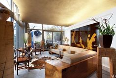 With his clients' collection of Asian art in mind, California-based designer Ron Mann refurbished a modern penthouse in London overlooking the Thames. In the main living area is a four-panel lacquered screen by Shiryu Morita.