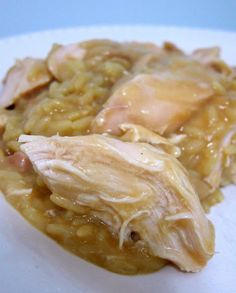 Crock Pot Chicken & Gravy  2 chicken breasts  1 cans cream of chicken soup  1 envelopes of chicken gravy mix  hot steamed rice  Combine all ingredients in a crockpot and cook on low for 4-6 hours. Before serving break the chicken breasts into bite sized pieces. Serve over hot steamed rice.