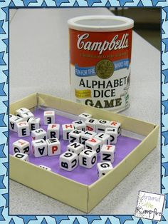 Alphabet dice available at Target and Toys R Us.  Place a foam sheet in a shoe box lid for quieter dice games!