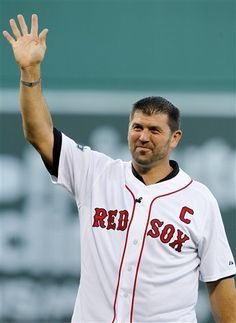 Former Boston Red Sox player Jason Varitek waves to the crowd during a ceremony to honor his time with the team, before a baseball game between the Red Sox and the Toronto Blue Jays, Saturday, July 21, 2012,  in Boston. (AP Photo/Michael Dwyer)