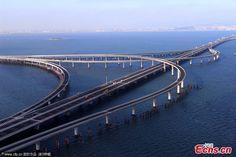 the qingdao jiaozhou bay bridge world longest cross sea engineering vehicles are seen