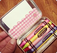 Altoid Tin Crafts (over 15 ideas!) one of the ideas, portable way of carrying some crayons for on the go kids activity.
