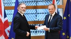 Sir Tim Barrow hands the letter to Donald Tusk