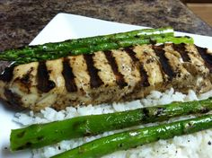 DJ Dave Diner 5/31 Jerk Seasoned Halibut Steaks - Did a wet seasoning of cinnamon, allspice, cloves, scotch bonnet peppers, nutmeg, reduced balsamic, and a few special spices, on top of coconut milk jasmine rice. If I can't be on vacation, at least it FEELS like the Caribbean!