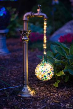 DIY Waterdrop Solar Lights   Easy, budget friendly and one of a kind DIY backyard ornaments and landscape lights   Upcycled candle sticks   Upcycled plant watering globes   Step-by-step tutorial for DIY waterdrop solar lights   DIY whimsical garden lights   Before & After   TheNavagePatch.com