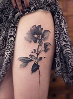 Black grey watercolor flower tattoo on thigh for women