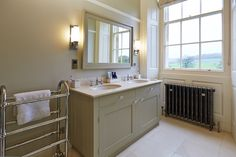 The decor was kept timeless with classicly styled sanitaryware and brassware and bespoke joinery. Georgian country house designed by Latham Interiors Country House Design, Vanity Units, Dream Bathrooms, Marble Top, Bathroom Furniture, Joinery, Georgian, Double Vanity, Home Interior Design