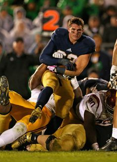 Notre Dame running back Cam McDaniel hilariously maintains perfect composure while getting tackled after losing his helmet on Oct. 19.
