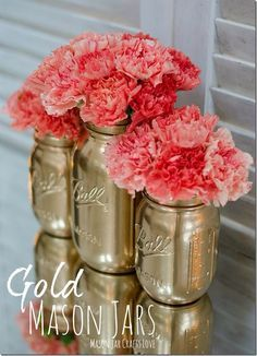 Coral flowers on gold painted mason jars.