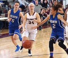 Phoot by Jen Marra/Wildwood's Jillian Freeman drives against two Burlington City players.