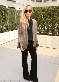 Fashionista in the house: Rachel Zoe donned a shimmery fringed cardigan over an all-black ...