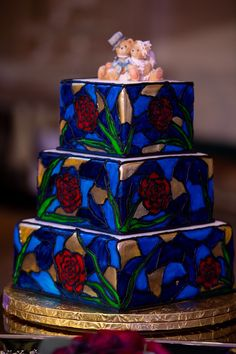 """Jessica and Wenbo had a Beauty & the Beast-inspired """"stained glass"""" wedding cake at their EPCOT wedding. Click to learn everything you need to know about Disney wedding cakes! Wedding Cake Prices, Wedding Cake Designs, Wedding Cakes, Wedding Ideas, Mad Hatter Wedding, Hijab Bride, Wedding Hijab, Wedding Dresses"""
