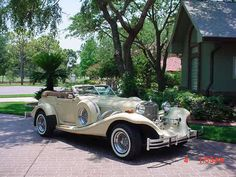 1984 Excalibur Series IV Phaeton-last year of the Series IV cars -French Vanilla- with matching painted top.-nice!!