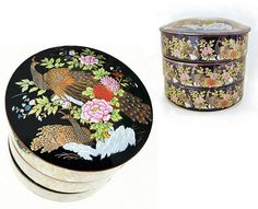 This Imperial Kutani jewelry box is unusual in that it contains three stacked jewelry bowls or dishes (not just one) beneath the beautifully ornamented lid. The background color of all is black, but the very upper edge of each bowl lightens slightly into a golden brown hue. The lid and the sides of the bowls are decorated with golden peacocks, pink and red chrysanthemums and peonies, and gilt-edged green foliage. Inside of each bowl is a small detailed flower with foliage. DIMENSIONS:  5…