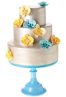 "WEDDING COLOR SCHEME: AQUA, YELLOW, AND IVORY  ""This cake feels very Cape Cod. And I'm obsessed with colored stands.""    Fondant cake with sugar flowers, $8.25 per slice (serves 80), Sweet Grace Cake Designs. Cake stand, $100, Fishs Eddy"