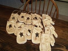 Primitive mittens....  Gift bags for Christmas party and then can be hung on the tree as an ornament.