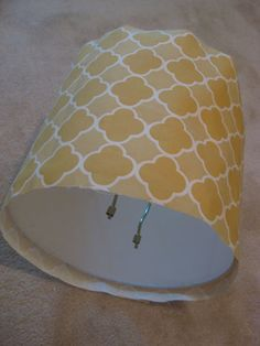Easy DIY tutorial on how to recover a lampshade with fabric