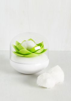 A ~blooming~ cotton ball/swab holder that'll make your beauty routine go that much smoother.