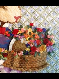 needlepoint basket with flowers (detail).
