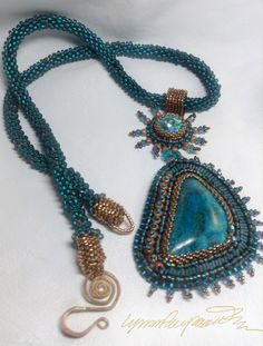 https://www.etsy.com/shop/LynnParpard?ref=listing-shop-header-item-count       One of a Kind ART Piece made one bead at a time . THis is a STUNNING    ..... Rare Bisbee Turquoise , the mine was closed in 1977 ....... The colors are  Outstanding ! THis could be in your collection.  Cabochon from Lost Sierra.