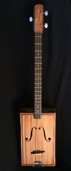 3-String fretted cigar box guitar made from recycled Mahogany door panel and Wenge fretboard and trim.  Vegetable steamer tailpiece,  Tuned GDg.  Made by Tom Thompson, Primitive Acoustics.