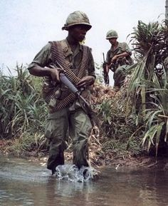 Soldier slung with M60 ammo. That was common way to carry it. From the looks of it, he is the assisant that will bring the actual M60 gunner the ammo in a fire fight. #vietnam #war