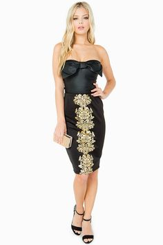 A scuba knit midi-skirt with a touch of regal class. Gold-toned damask foil in the front. Elasticized waist. Finished hem. Unlined. Pair strapless top and heels for a lovely evening look.