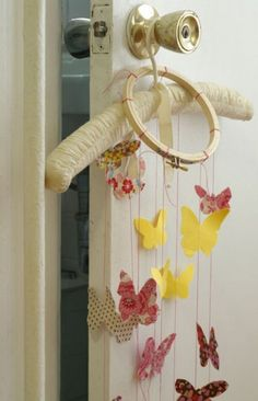 Butterflies cut from cotton fabrics flutter and twirl on this simple-to-make mobile.