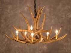Hey, I found this really awesome Etsy listing at https://www.etsy.com/listing/179656499/antler-chandelier-d6-faux-antler