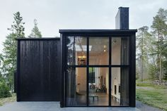 Wood House Sweden glass facade transparent architecture design