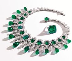 The late Brooke Astor's emerald and diamond ring and necklace. The ring holds a 22.84 carat Colombian emerald.