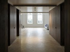 Queens Court Apartment, London - Feilden Fowles Architects Architecture Contemporary Modern Design Residential Apartment London West End Parquet Floor Walnut Timber Panel Concrete Worksurface Kitchen Layout Shelves Books Fireplace Sliding Wall Sash Windows Steel Columns Material Pallette 1930's