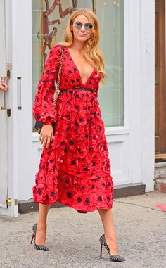 Coming up poppies! The fashionista dressed in a floral red dress shops at Christian Louboutin after attending a fashion show.