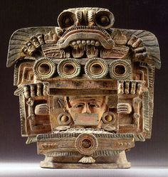 STAR GATES: A MAN IN HIS ADVANCE MACHINE??? LOOKING OUTSIDE THE WINDOW??? WHAT IS THE MESSAGE??? WHAT DO YOU SEE??? Teotihuacan incensario lid, Pacific Slope Region, Escuintla style, circa A.D. 450-650