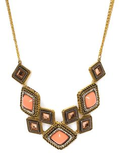 $32 This striking statement necklace evokes all the boho glamour of the Seventies, Ossie Clark-style. With its braided gold, coral stones and geometric allure, it's retro in an utterly chic way.