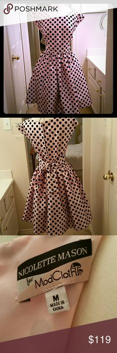 ModCloth Mad Men Pink & black polka dots dress Absolutely gorgeous retro style dress by Nicolette Mason for Mod Cloth!  Features petal pink sateen fabric with black velvet polka dots all over.  Zippered back and bow tie at waist.  Attached crinoline slip for extra poof.  Size Medium.  New without tags. ModCloth Dresses Midi