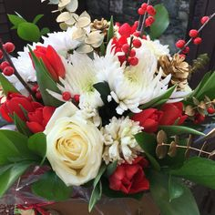 Gorgeous chrysanthemums, roses, tulips, hyacinths, ilex, gold sprayed eucalyptus and ruscus together in a hand tied bouquet