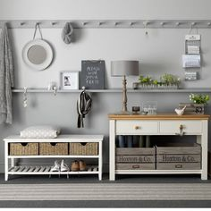 Grey/ivory hallway: flooring from Crucial Trading, Shoe Bench from Dunelm Mill and Console from Furniture Village.  Looks capable but cares about its appearance.  Grey is chic but a very forgiving colour for a heavy traffic area.